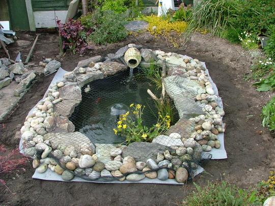 New pond finished today grows on you for Garden pond stones