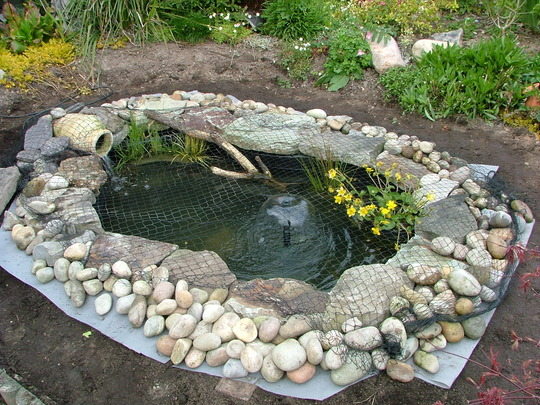 New pond finished today grows on you for Garden pond edging stones
