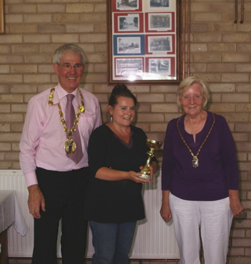 The mayor presenting me with the first prize trophy