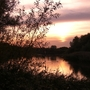Sun_setting_over_Bedfont_Lakes__View_from_Bitten_Hide.jpg