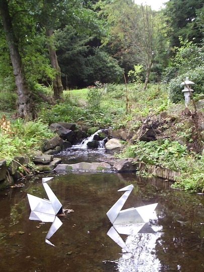 """Origami"" style metal Swan Sculptures in the Japanese Garden, Atholl Palace Hotel, Pitlochry, Perthshire."