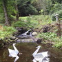 """""""Origami"""" style metal Swan Sculptures in the Japanese Garden, Atholl Palace Hotel, Pitlochry, Perthshire."""