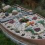 Filled boat in Seaside garden