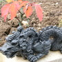 dragon ornament under the bonsai cherry tree