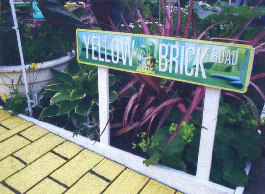 yellow brick road metal sign