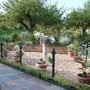 Gravel area with planting, raised bed constructed from green French Oak timbers, 26 ft long by 12 ft wide and 2.5 ft high.