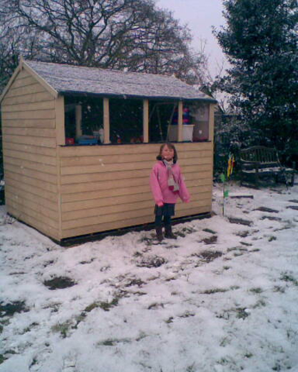 Jenny Snow outside her shed