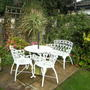 table and chairs (Hydrangea aspera (Hydrangea) miscanthus sinensis)