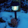 A Solar Lamp Braving The Snow