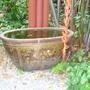 Water jar in Jim Thompsons garden