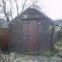 Shed at end of plot.