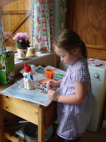 Grandaughter painting her gnome