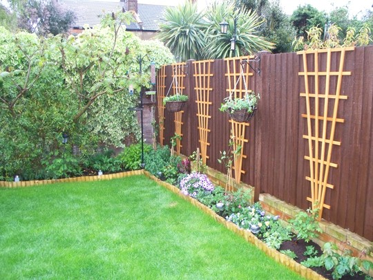 Flower Baskets On Fence : Side fence with hanging baskets grows on you