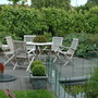 our neighbours' patio near the pond, secluded from the east by a grape vine