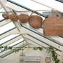 old wicker baskets in conservatory
