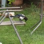 Magpie pecking away at the patio chair