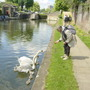 me trying to lure swans at the Regent's Canal (near Camden) -May 2004