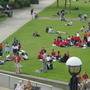 colourful  school-children on the grass near The City Hall  -May 2004
