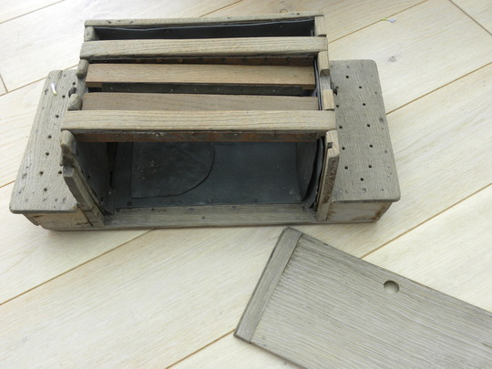 wooden box  used as a stove