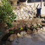 Small rock garden with trellis