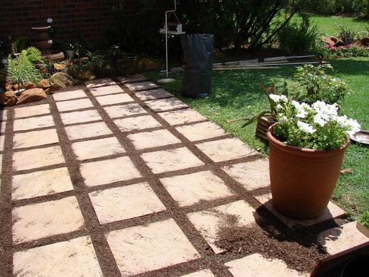 Preparing the paving stones for the seedlings