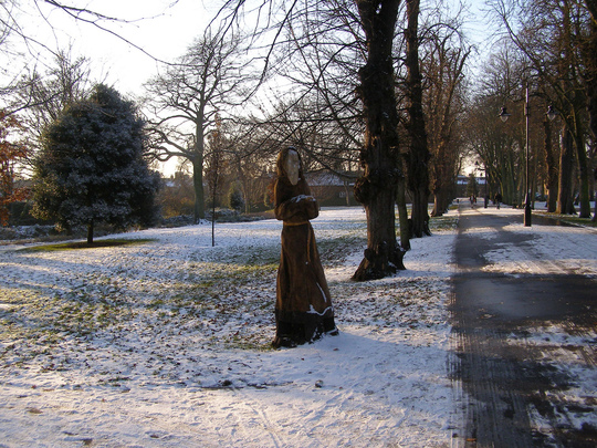 Monk carved from a dead tree trunk in Kings Lynn Park