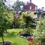 Lawn with fruit trees and flower beds.
