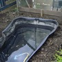 pond set in ground and backfilled