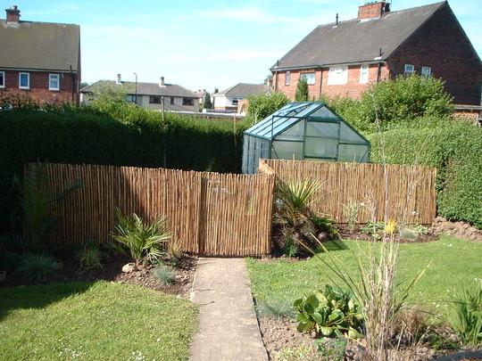 Left hand side on back garden