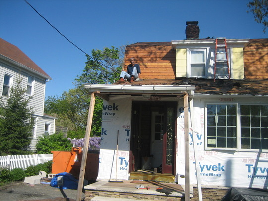 New Roof going up Front Door on & Front Window in