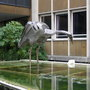 A giant statue made from metal of a grey heron outside the police station in warwick.