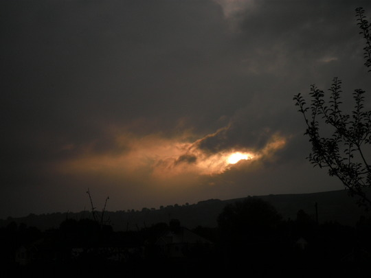 distant disappearing sun