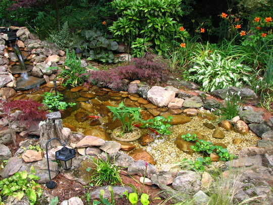 The finished product, we had to put some bamboo shoots on the top two waterfalls to get a strong flow of water to run into the lower pond. Our pump isn't strong enough to get a consistant flow, It looks like another pump is our next project.