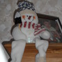SNOWMAN SITTING ON THE BOOKCASE