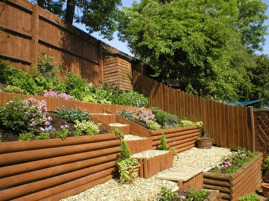 Sloping garden ideas for beeanddave for Backyard garden ideas