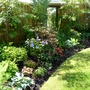 Woodland border with addition of new blue hydrangea (Hydrangea macrophylla (Hortensia))