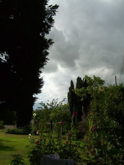 View up the garden of the storm clouds