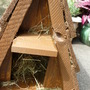 Hedgehog homes now filled with hay and being placed in the garden under the espaiel apple trees.
