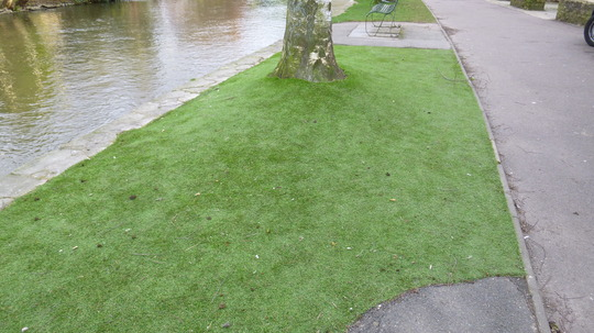 FOR FRANL155 - Artificial Grass by the river in Bourton on the Water.