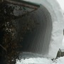 Snow very slowly sliding off roof