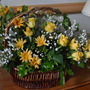 Basket arrangement with Yellow Roses.