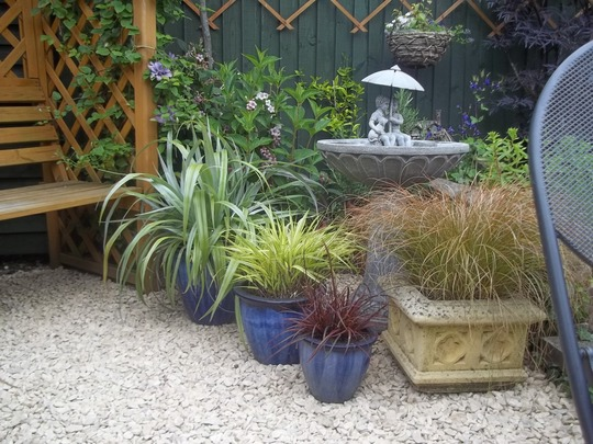This corner looks much better now and shows off the pots !