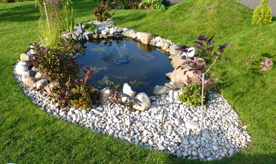 Little solar floating fountain in the pond.