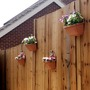 Planters in fence