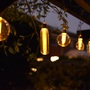 Garden Solar lights hanging from pergola.
