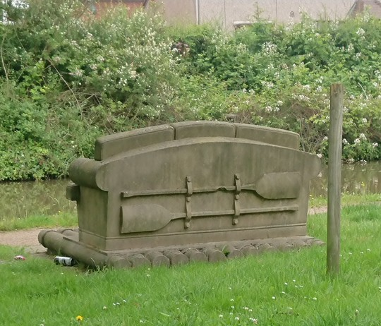 Detail on rear of stone carved sofa on  canal