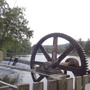 Large cogwheels at weir