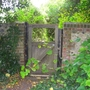 Churchyard gate leading to private garden in Bosham