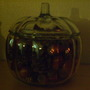 Glass pumpkin with pinecones (real) and acorns (fake).