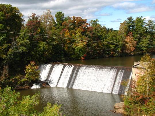 Icard Dam with fall colors beginning to show
